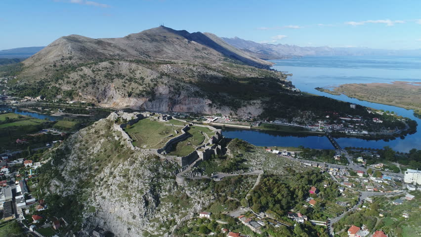Tilting aerial footage of remains of fort, castle, and defense walls in Shkoder, a small city in Northern Albania