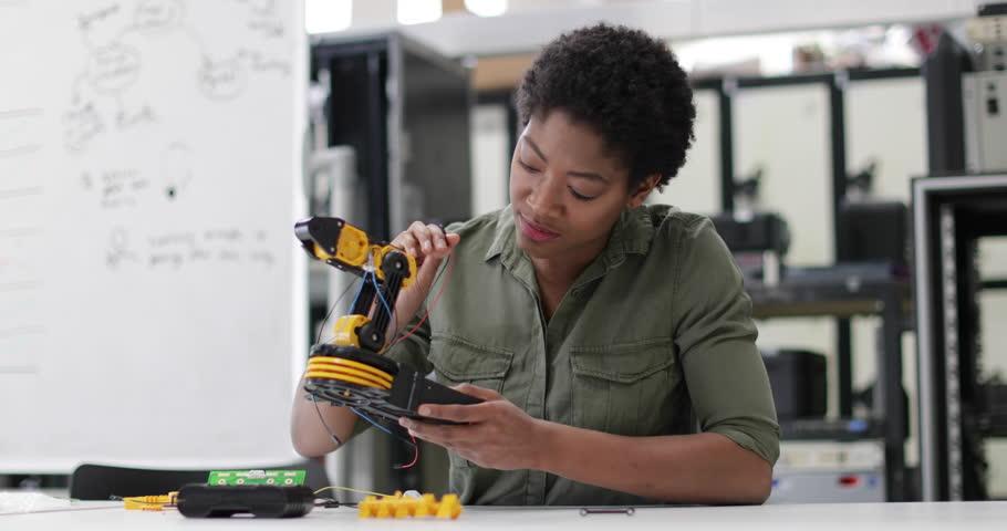 Female working on robotics