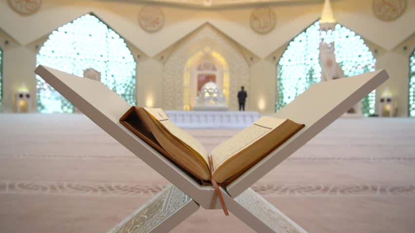 A Muslim man reads a koran or quran in an Islamic mosque   Shutterstock HD Video #1008348106