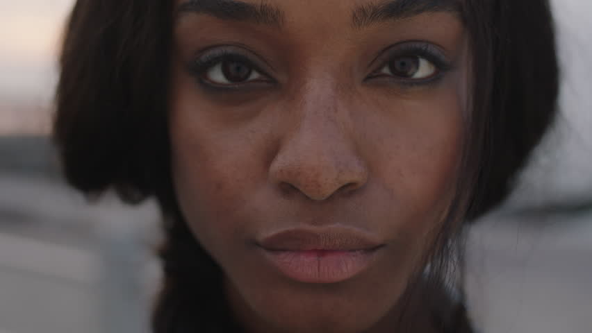 close up portrait of beautiful african american woman looking to camera intense focused #1008365416