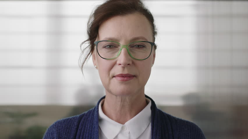 portrait of successful senior business woman boss looking serious confident at camera wearing glasses in office workspace background close up #1008367759
