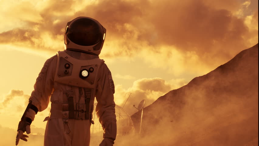 Handheld Side View Shot of the Astronaut Ascending Mountain on the Mars/ Red Planet. First Man on Alien Planet Overcoming Difficulties. Shot on RED EPIC-W 8K Helium Cinema Camera.