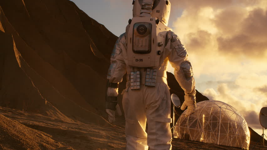 Following Shot of the Astronaut On Mars Walking Toward His Base/ Research Station. Manned Mission To Mars, Technological Advance Brings Space Exploration, Colonization. Shot on RED EPIC-W 8K Helium.