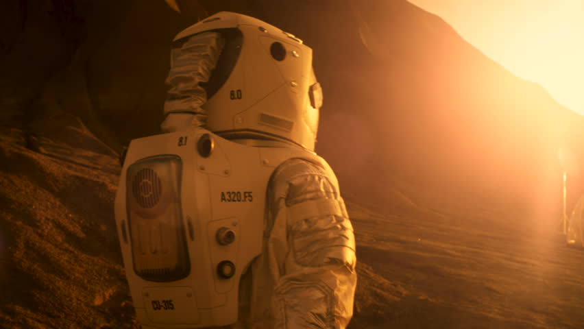 Following Shot of the Astronaut On Mars Walking Toward His Base/ Research Station. Near Future First Manned Mission To Mars, Technological Advance Brings Space Exploration, Colonization. 4K UHD.