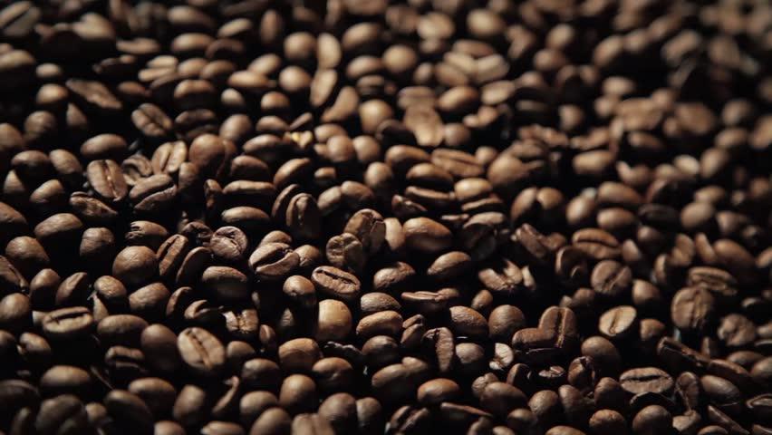 Coffee close up motion dark grains full hd. #1008393499