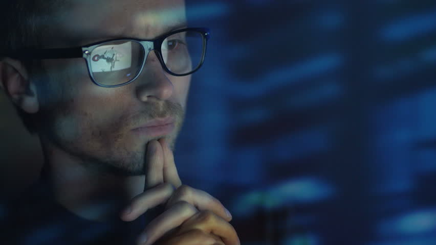 The face of the thinking person in glasses. evening night time | Shutterstock HD Video #1008423670