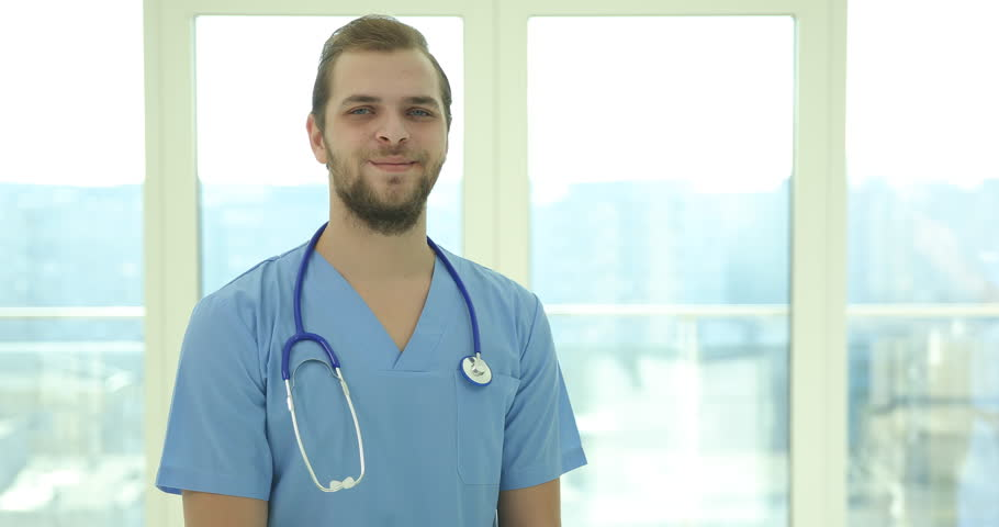 Happy Medical Doctor Man Looking Camera and Negative No Answer in Hospital Room | Shutterstock HD Video #1008443926