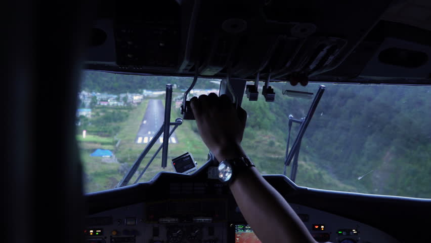 Landing aircraft at Tenzing-Hillary Airport in Lukla. Cockpit view of plane landing. The airport in Lukla is the most dangerous airport in the world.