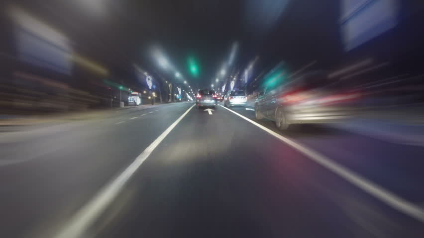 BELGRADE, SERBIA - FEBRUAR 18. Timelapse point of view of traffic and neon lights on the streets of Belgrade in Serbia at night. POV shot of a car driving through the city. 18. februar 2018. | Shutterstock HD Video #1008482137