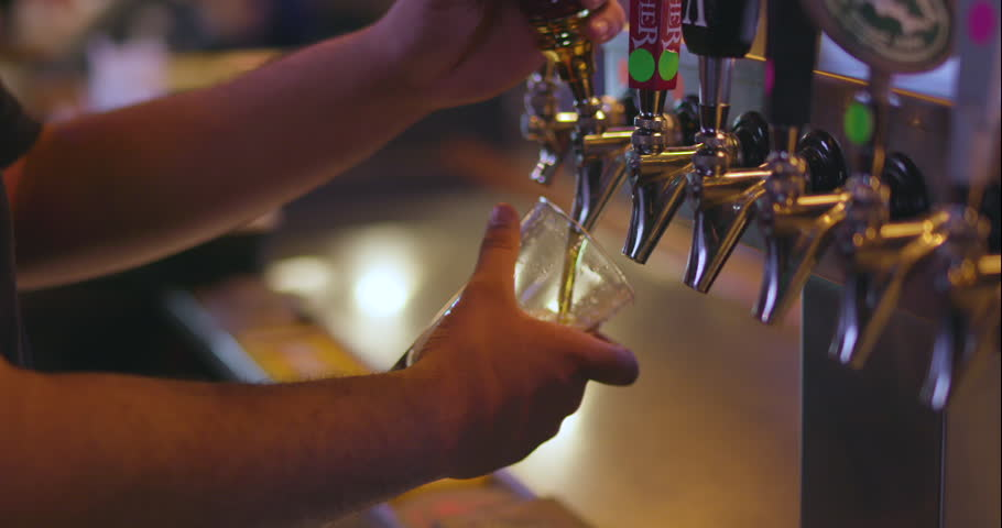 Bartender Pouring Craft Beer from Tap into Pint Glass at Restaurant Bar / Brewery | Shutterstock HD Video #1008483082