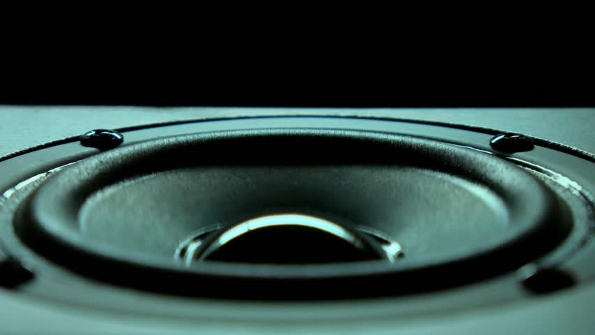 Closeup at moving sub-woofer. Speaker part music. Background.