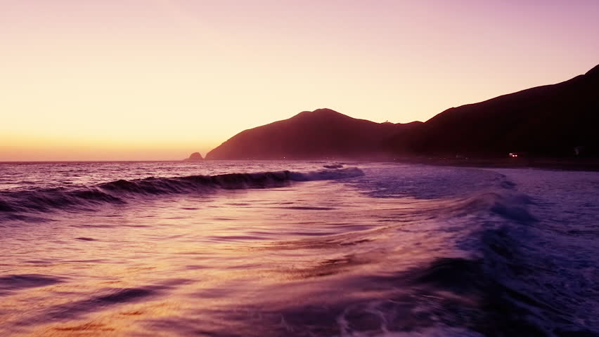 Los Angeles Aerial Drone Flyover of Malibu beach at sunset