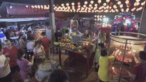 BAYAN LEPAS, PENANG/MALAYSIA - 20 FEB 2018: Chinese folks pray at the temple.