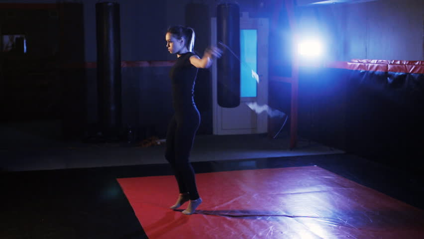 Girl with a rope jumping in the gym | Shutterstock HD Video #1008510172