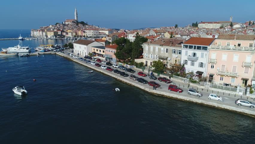 ROVINJ, CROATIA - NOVEMBER 2017: Low angle drone flight to Rovinj port and historic town, located on Istria peninsula, a popular holiday destination in Croatia | Shutterstock HD Video #1008517870