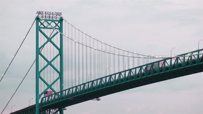 Ambassador Bridge in Detroit Michigan with Trucks Passing Between the USA and Canada