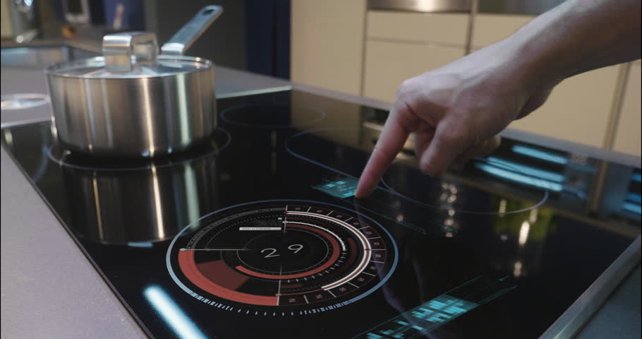 Close up of a man who cooks in his own home on a stove of the latest technology and regulates power and intensity thanks to holography. Concept of: future, technology, kitchen, augmented reality. #1008523846