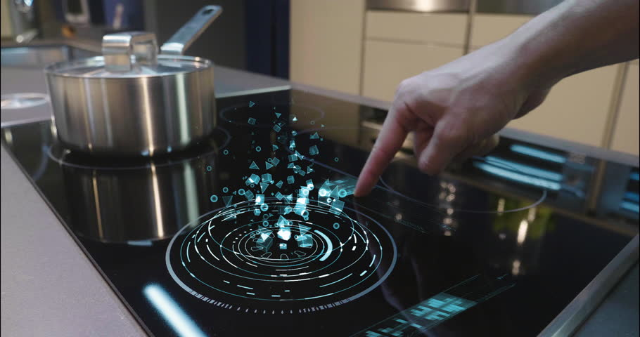 Close up of a man who cooks in his own home on a stove of the latest technology and regulates power and intensity thanks to holography. Concept of: future, technology, kitchen, augmented reality. | Shutterstock HD Video #1008523852