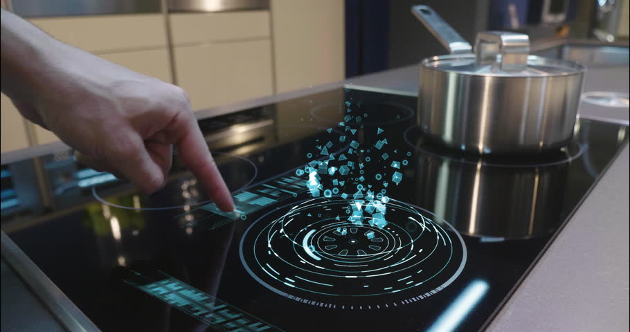 Close up of a man who cooks in his own home on a stove of the latest technology and regulates power and intensity thanks to holography. Concept of: future, technology, kitchen, augmented reality. | Shutterstock HD Video #1008523861