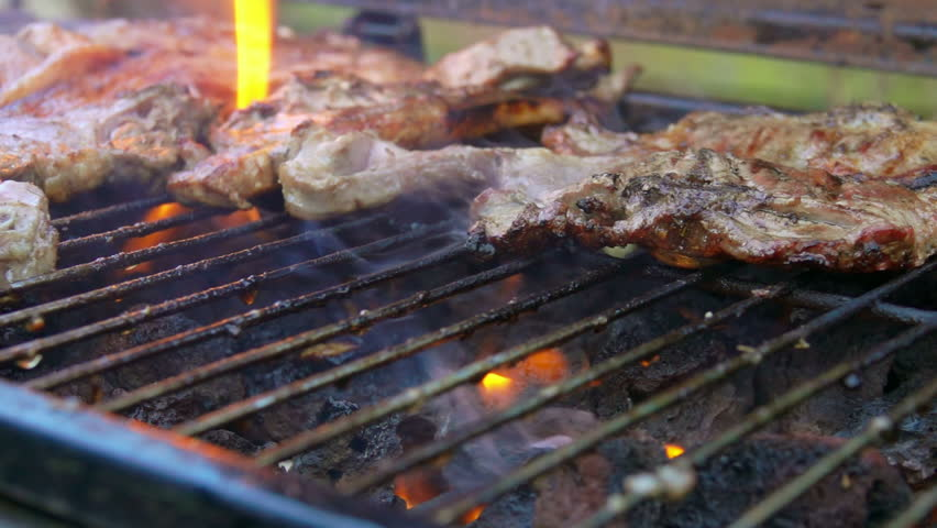 Piece of lamb steak roasted and flipped on the grill. | Shutterstock HD Video #1008525427