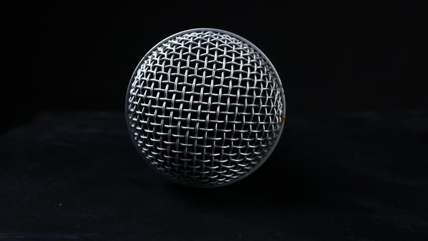 Steel grille background. Close-up shot of microphone | Shutterstock HD Video #1008562678