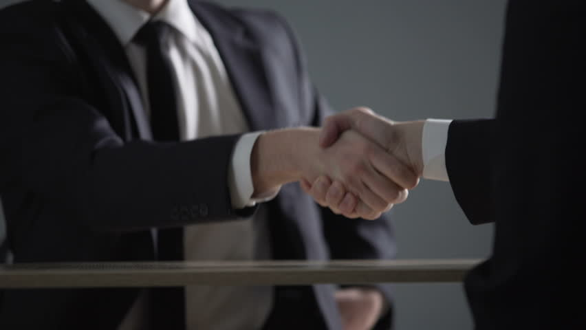 Partnership agreement based on corruption, business handshake in illegal deals