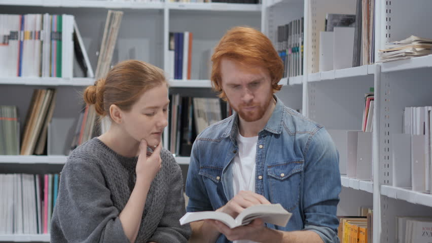 Serious Students Searching Information in Book in Library Royalty-Free Stock Footage #1008600001