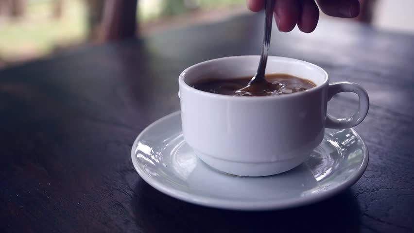 Stir the hot coffee in a cup with a spoon. slow motion, 1920x1080, full hd Royalty-Free Stock Footage #1008602587