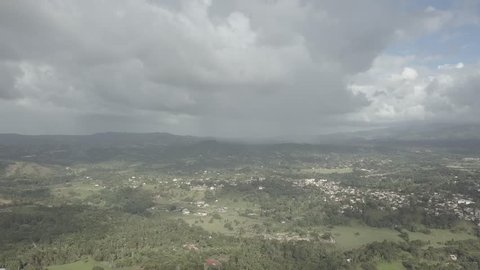 Aerial view on Jarabacoa mountains and forests through the clouds