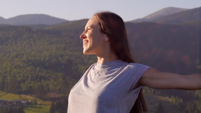 Happy woman spinning at sunset in mountains   Shutterstock HD Video #1008609247