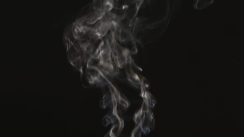 Beautiful gray smoke on a black background. Cigarette smoke. Smoke from the hookah. Turbulence of smoke. The white vapor rises. . #1008631462