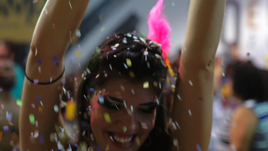 Woman Dancing and Celebrating with Confetti at Brazilian Carnival, Salvador, Bahia