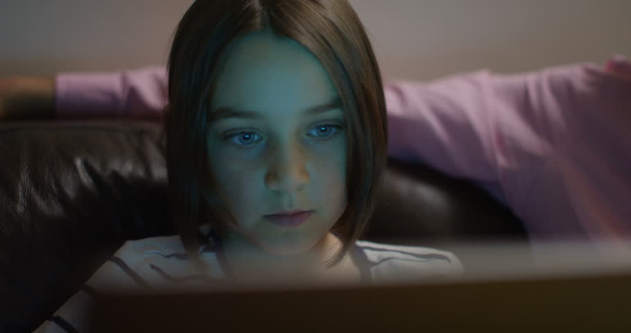 4K Close up on face of little girl, watching computer screen & reacting with surprise. Slow motion. | Shutterstock HD Video #1008651826