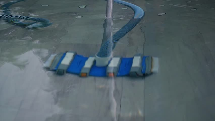 A special brush with a striped hose cleans the pool. slow motion, 1920x1080, full hd | Shutterstock HD Video #1008655381
