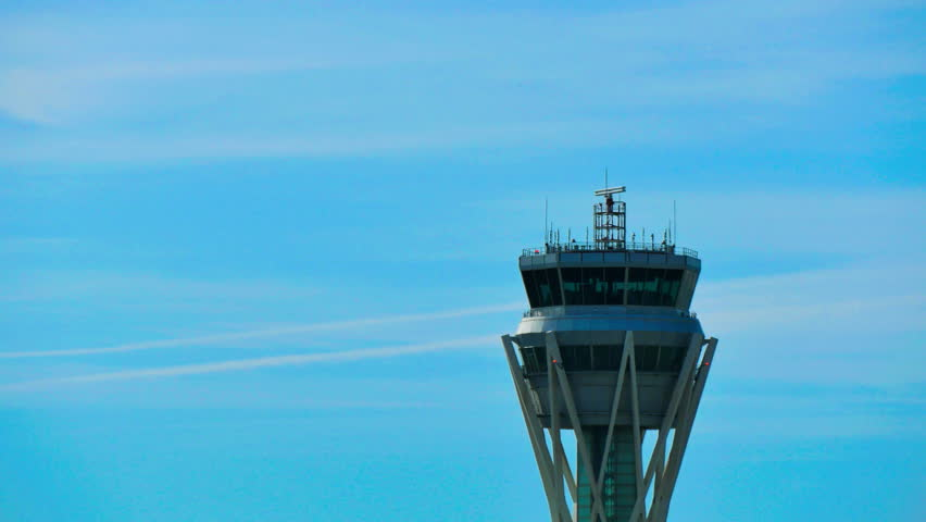 Barcelona Airport Radar Traffic Control Tower. Air Traffic Control Tower at Barcelona Airport with flying plane in sky.