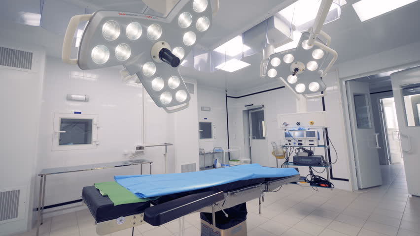 Wide angle view of a hospital operating room with two surgical lamps | Shutterstock HD Video #1008684496