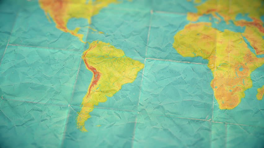 Zoom in from World Map to South America. Old well used world map with crumpled paper and distressed folds. Muted vintage colors. Blank version