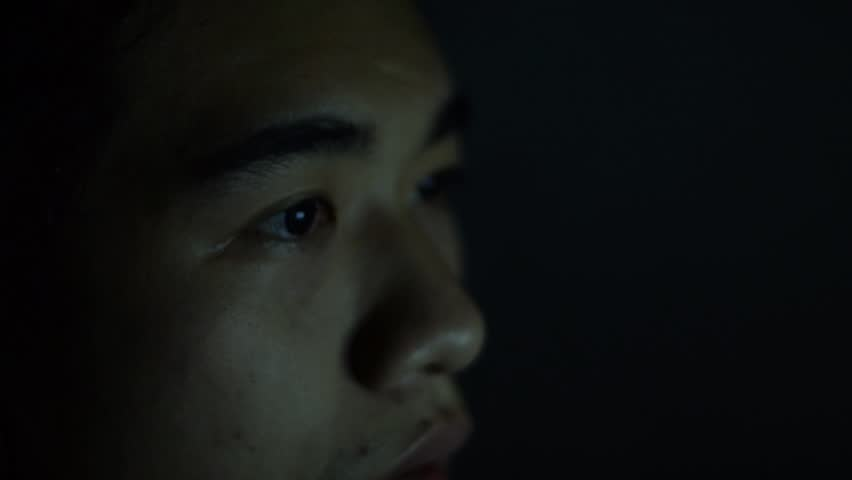 Close up face asian man, freelance man have working on midnight,illusion a monitor desktop on his eye.Closeup shot of boy eye surfing internet at night | Shutterstock HD Video #1008685123