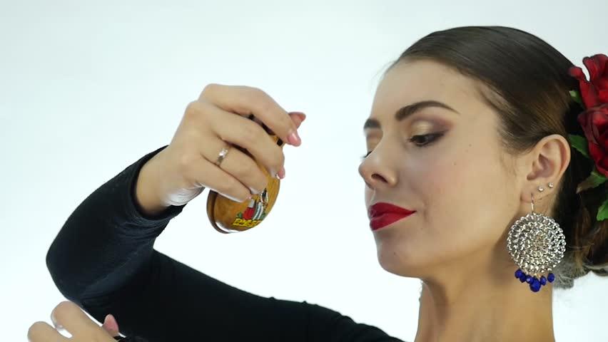 Close-up flamenco dancer on a light background. slow motion