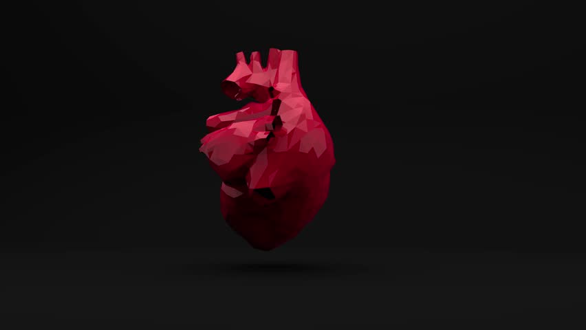 The red polygon heart beats. Computer three-dimensional graphics. Slow rotation of the object.