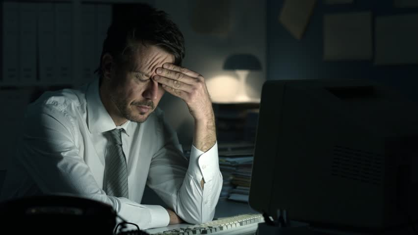Tired frustrated business executive working late at night in the office, he is staring at the computer screen and receiving an error message | Shutterstock HD Video #1008714404