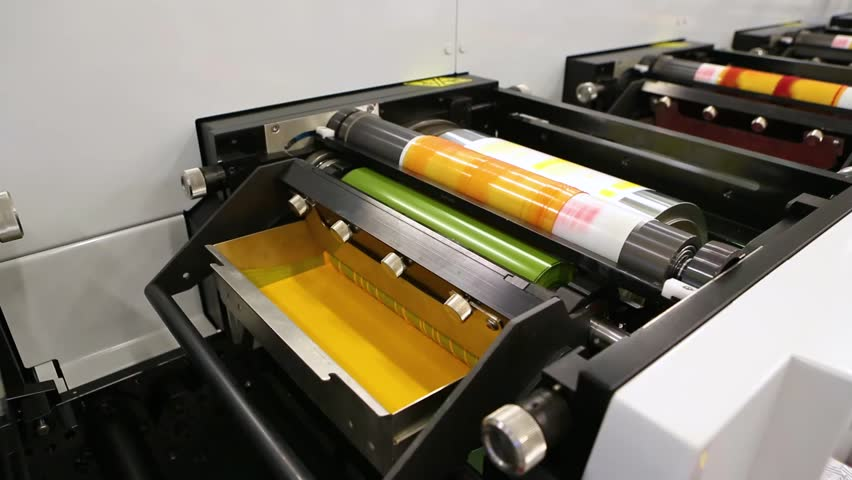 Flexography printing process on in-line press machine. Video of photopolymer plate stuck on printing cylinder, substrate is sandwiched between the plate and the impression cylinder to transfer the ink | Shutterstock HD Video #1008722072