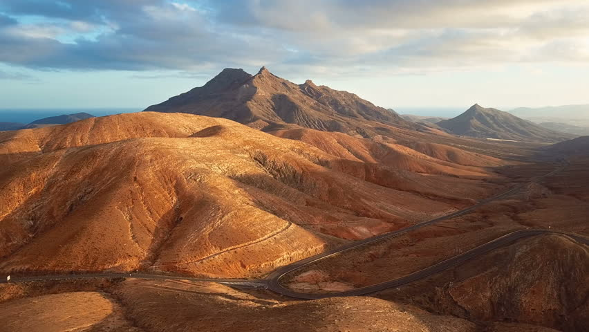 Aerial view of desert landscape at sunset, Fuerteventura island, Spain | Shutterstock HD Video #1008725864
