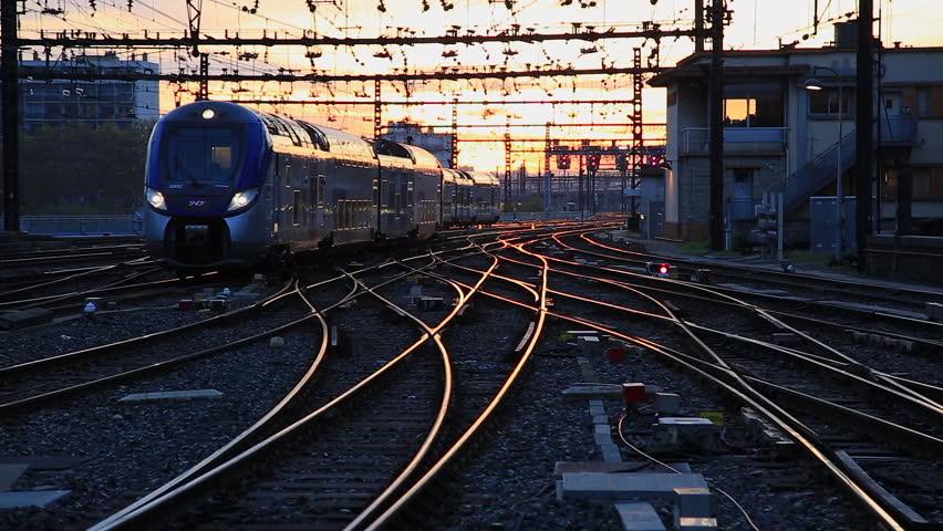 PERRACHE STATION, LYON, FRANCE -  October 26,  2017: Train entering train station Gare de Lyon-Perrache at dawn. Lyon, France. | Shutterstock HD Video #1008736931