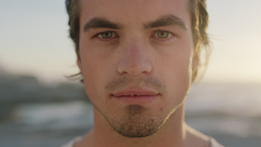 Close up portrait of attractive man staring looking intense eyes