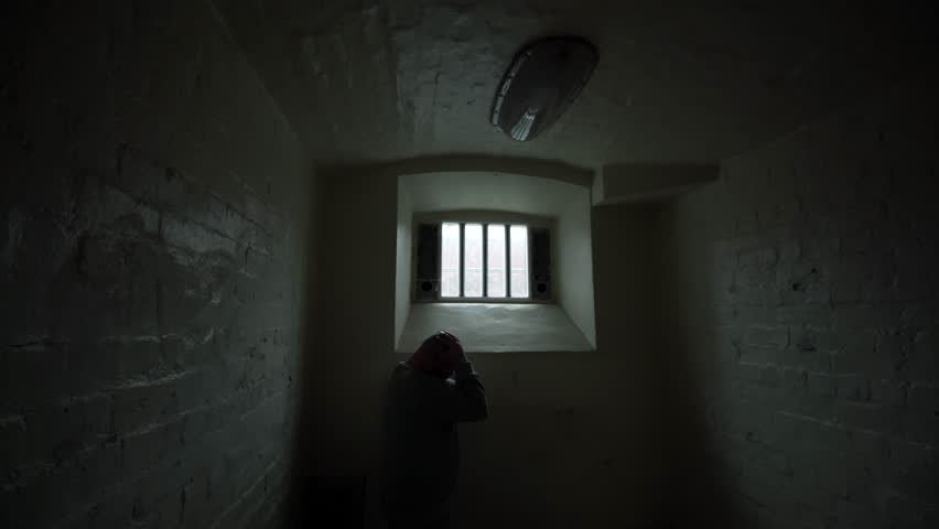 Prisoner In Cell, Sad Regret, Head In Hands Alone, Prison Solitary Confinement. Part Of A 4K Collection With A Variety Of Camera Angles And Stories.