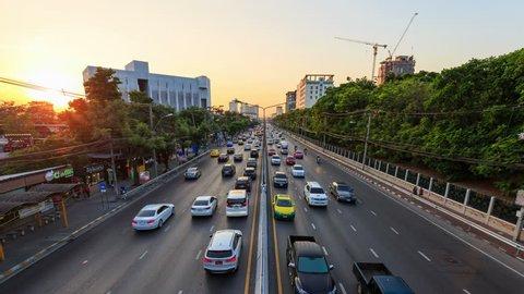 Bangkok, Thailand - March 3, 2018: 4k Day to Night Time-lapse of traffic on Ngamwongwan Road at Kasetsart University in bangkok, Thailand
