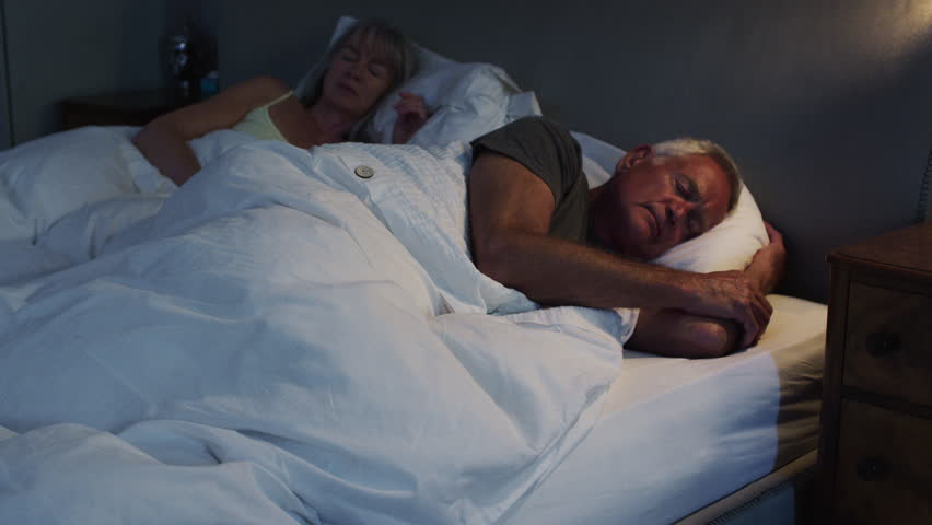 Peaceful Senior Couple Asleep In Bed At Night | Shutterstock HD Video #1008755003