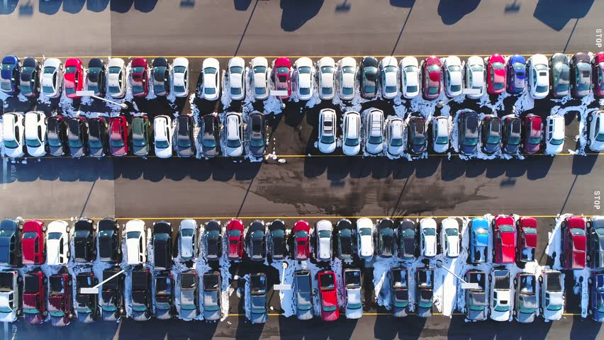Car lot, in Springtime, many vehicles for sale, aerial view.  | Shutterstock HD Video #1008758804