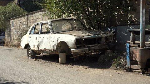 MITROVICA, KOSOVO - OCTOBER 2017: Neglected car wreck in North Mitrovica in Kosovo